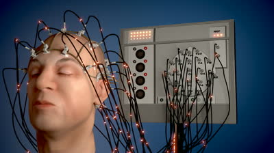 stock-footage-man-wired-to-an-eeg-machine-or-electroencephalograph-which-produces-a-graphical-record-of