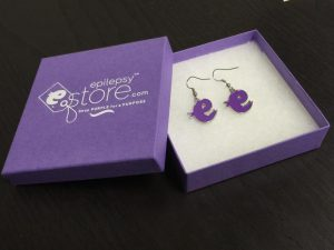 "EpilepsyStore.com sells unique, custom-branded jewelry items such as these ""purple e ribbon"" awareness earrings."
