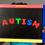 girl-holding-autism-sign