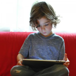 child_reading_ipad