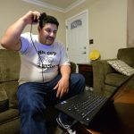 Richard Lopez Jr., of Tracy, who has epilepsy, uses a monitor that is connected to a computer at his home to collect information from a small neurostimulator in his skull to a Patient Data Management System in Tracy, Calif., on Friday, Feb. 22, 2017. Lopez, who has had grand mal seizures since he was a teen, had a device implanted in his skull that works like a pacemaker for the brain to stop the seizures. The $40,000 implantable neurostimulator device is made by a Mountain View firm called NeuroPace. (Doug Duran/Bay Area News Group)